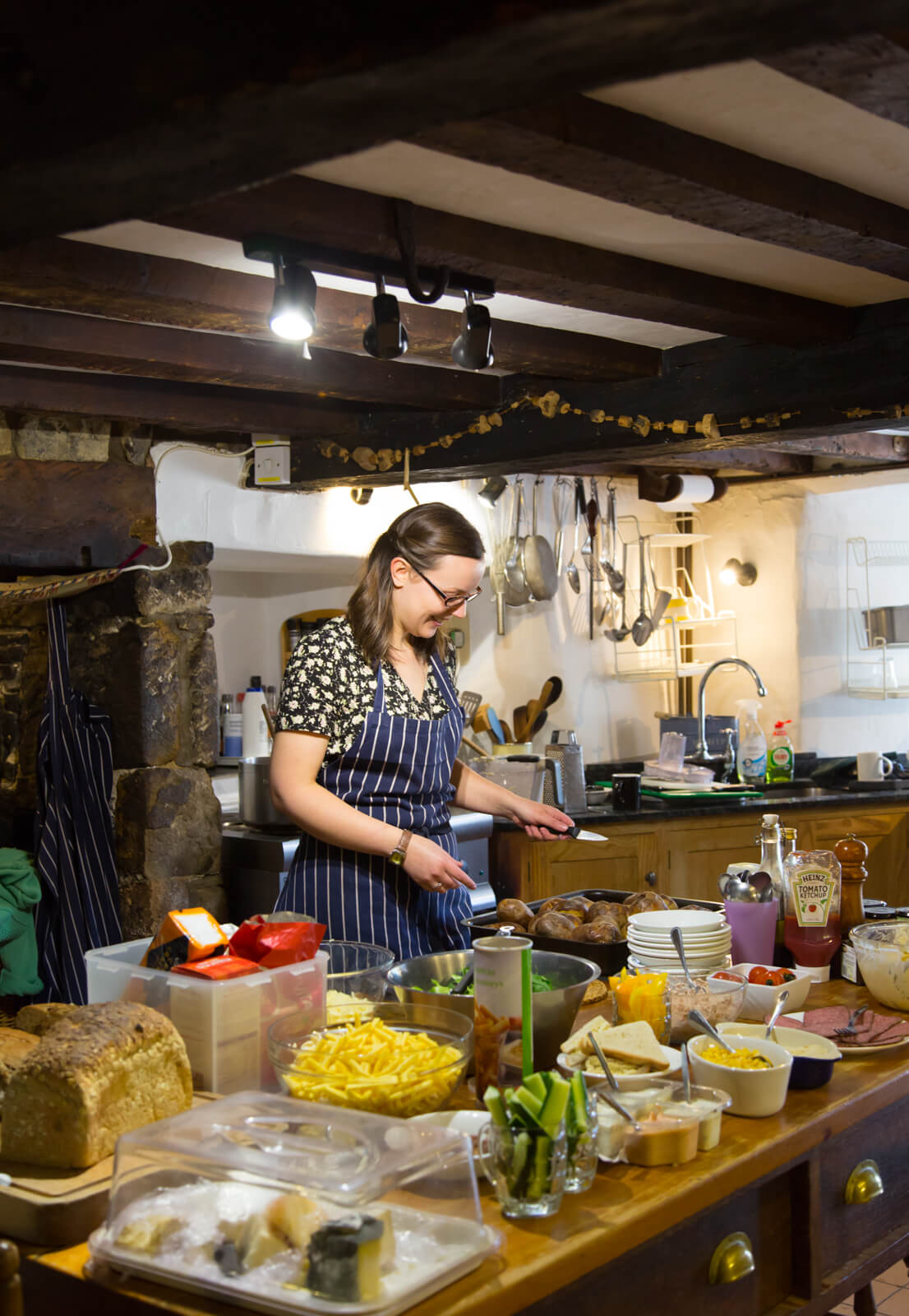 Eliza preparing food for writers at Totleigh Barton