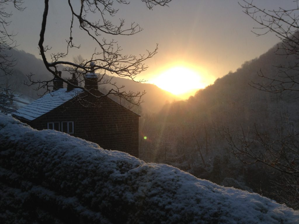 Sunrise over Lumb Bank valley in snow