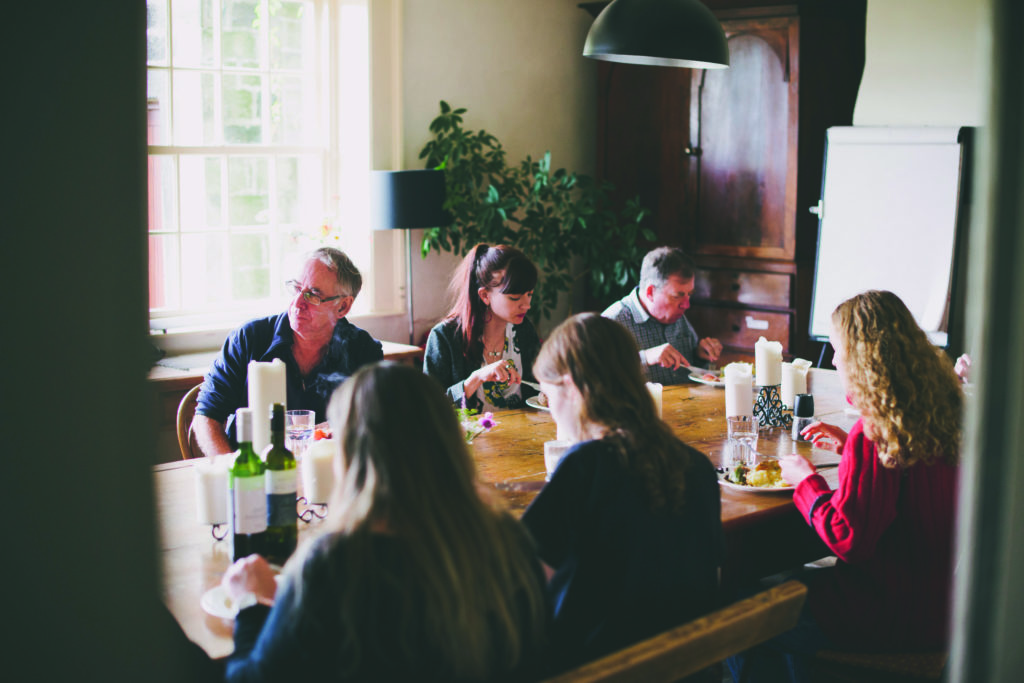 Arvon writers eating together during a course at Lumb Bank
