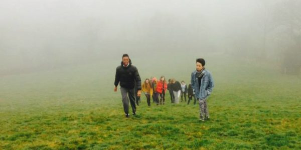 Writers walking up hill at Totleigh Barton