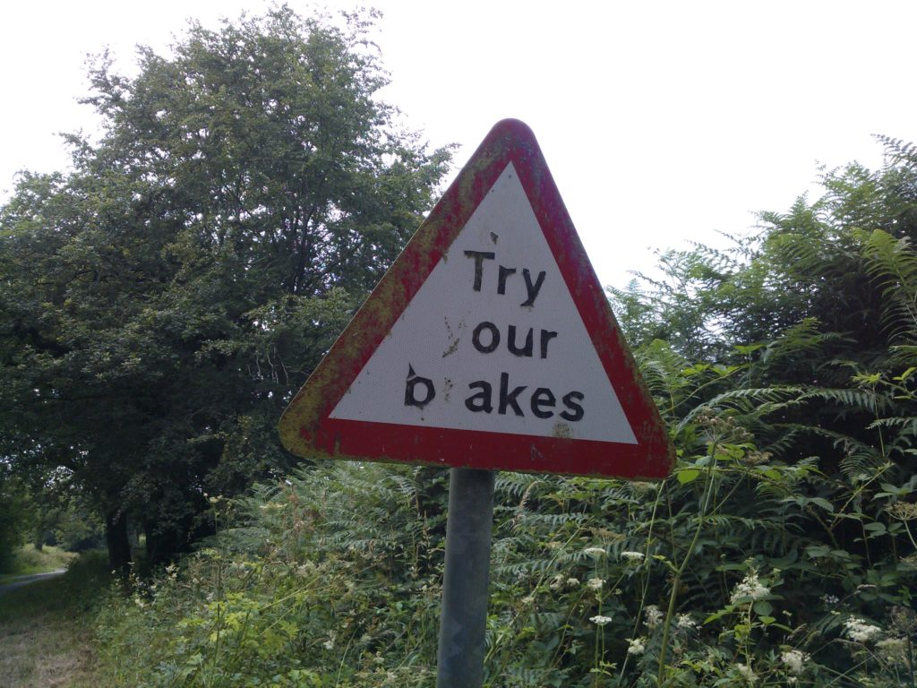 Try your breaks road sign