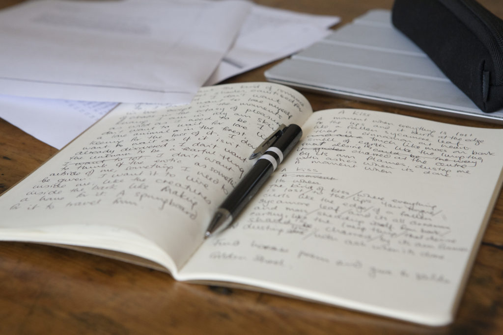Notebook on a table during an Arvon course